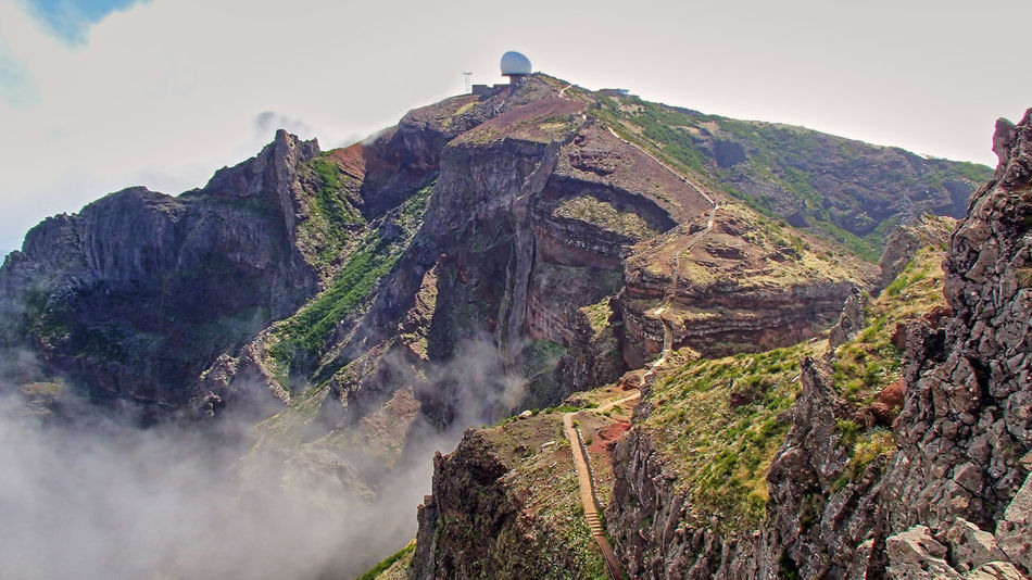 The white ball an observatory in the clouds in the mountains of the porugiesischen Atlantic island of Madeira Island Hiking Madeira Observatory Trekking Beauty In Nature Cliff Day Dramatic Geology Highest Landscape Mountain Mountain Range Nature No People Outdoors Physical Geography Rock - Object Rock Formation Rocky Mountains Scenics Sky Telecommunication Tranquil Scene Tranquility