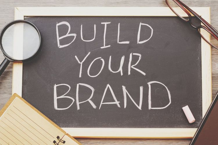 Build your brand concept Concept Conceptual Build Your Brand Branding Marketing Chalkboard Blackboard  Chalk Board Background Wooden Smart Phone NotePad Notebook Text Word Blackboard  Communication Text Message Close-up Capital Letter Signboard