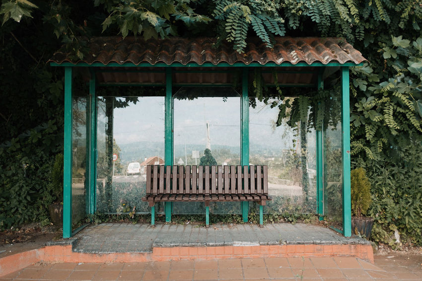LOST IN GALICIA 🚌 Lostingalicia Threeweeksgalicia Bus Stop Architecture Plant Built Structure No People Day Tree Nature Absence Bench Old Seat Outdoors Empty Park Growth Roof Building Exterior Park - Man Made Space Entrance House
