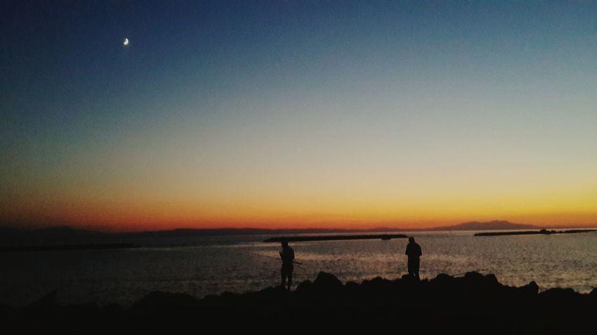 Sea Sunset Silhouettes Enjoying The Sunset