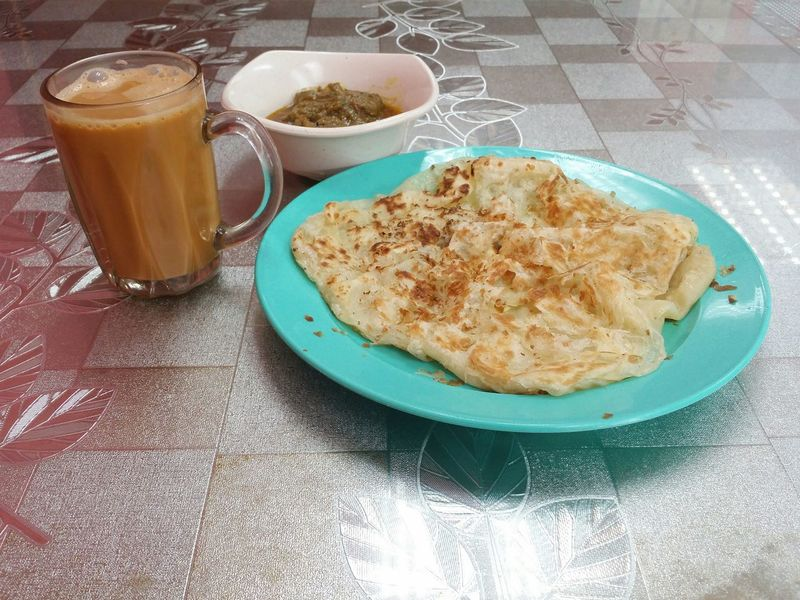 Pulled Tea Breakfast Roti Canai Roti Canai And Curries Tea Plate Table Homemade High Angle View Bread Close-up Food And Drink