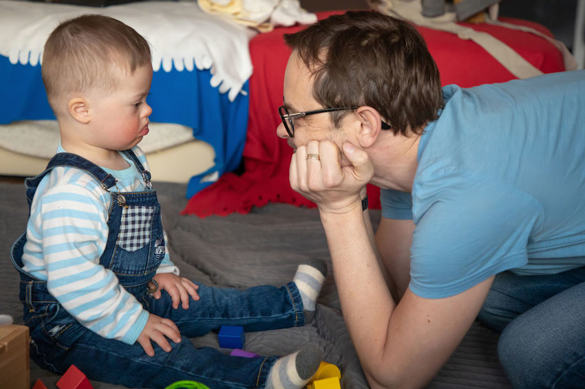 Babyboy Bonding Boys Brother Casual Clothing Child Childhood Down Syndrome Family Indoors  Innocence Leisure Activity Lifestyles Males  Men Mental Health  Positive Emotion Real People Sister Sitting Son Three Quarter Length Togetherness Two People