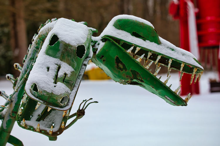 Close-up of green toy hanging on snow