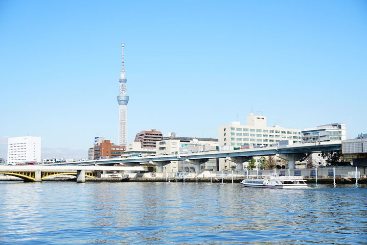 Tokyo Skytree and boat in Sumida River Boat Sumida River River Tokyo Japan Reflections Cityscape City Water Nautical Vessel Harbor Sailing Ship Sea Yacht Blue Modern Yachting Marina Skyscraper Urban Skyline