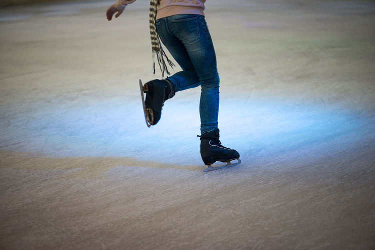 Ice Rink Adult Casual Clothing Day Girl Human Leg Ice Skates Iceskating Jumping Low Section Men Mid-air Motion One Person Outdoors People Real People Skateboard Skill  Young Adult Shades Of Winter