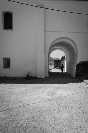 Shadows & Lights Textures And Surfaces Adult Arch Architecture Arts Culture And Entertainment Blackandwhite Photography Building Exterior Built Structure Day Full Length Indoors  Leisure Activity Lifestyles Men Old Buildings People Real People Walking Women