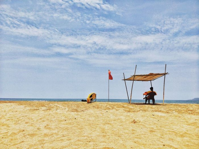 Being a lifeguard can be stressful so a little relaxation is important. Incredibleindia Goatourism Goa EyeEm Selects Land Beach Sand Day Nature Sky Real People Outdoors