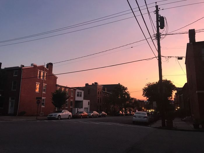Baltimore Car Architecture Street Cable Power Line  Built Structure Sunset Building Exterior Electricity  Power Supply Electricity Pylon Land Vehicle Transportation Road Connection Sky City Outdoors Tree Low Angle View Baltimore