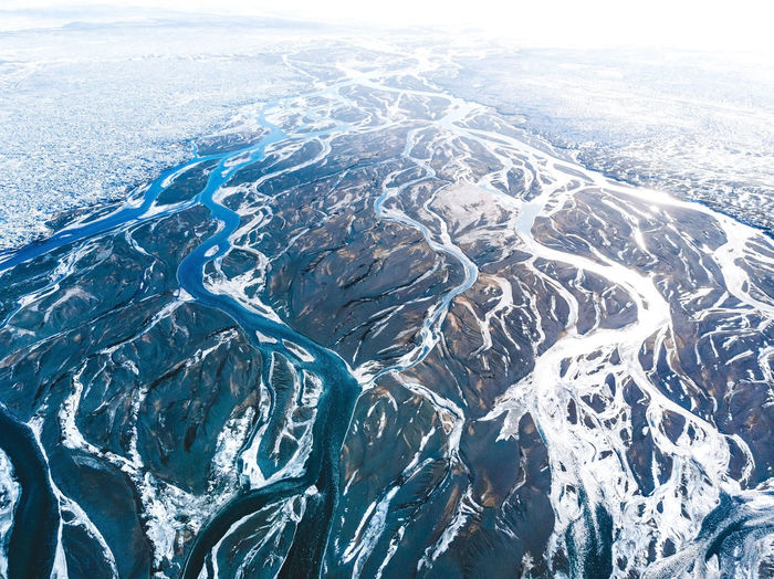 Find more travel inspiration at http://www.instagram.com/simonmigaj Flow  Iceland Landscape Photography Vein Aerial View Art Background Backgrounds Beauty In Nature Cold Temperature Day Flower Landscape Landscapes Nature No People Outdoors River Scenics Sea Sky Snow Water Winter