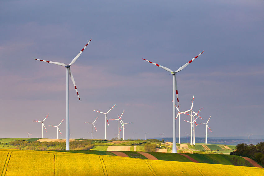 Alternative Energy Beauty In Nature Day Environmental Conservation Field Fuel And Power Generation Industrial Windmill Landscape Nature No People Outdoors Renewable Energy Rural Scene Sky Tranquility Wind Power Wind Turbine Windmill