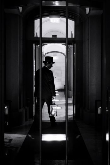 Capture Berlin Indoors  One Person Rear View Well-dressed Suit Men One Man Only People Olympus Streetphotography Monochrome Blackandwhite Candid Lantern Door Hotel Hat Reportage The Street Photographer - 2017 EyeEm Awards