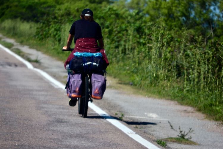 On the way...alone. Bicycle Bike Rider Biker Cycling Day Land Vehicle Lifestyles Men Mode Of Transport Nature One Man Only One Person Only Men Outdoors Real People Riding Road The Way Forward Transportation