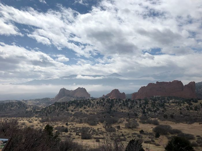 Pikes Peake hiding in the clouds Pikes Peak Garden Of The Gods Colorado Cloud - Sky Sky Mountain Tranquil Scene Scenics - Nature Landscape Plant Mountain Range No People Tranquility Tree Beauty In Nature Nature Environment Day Land