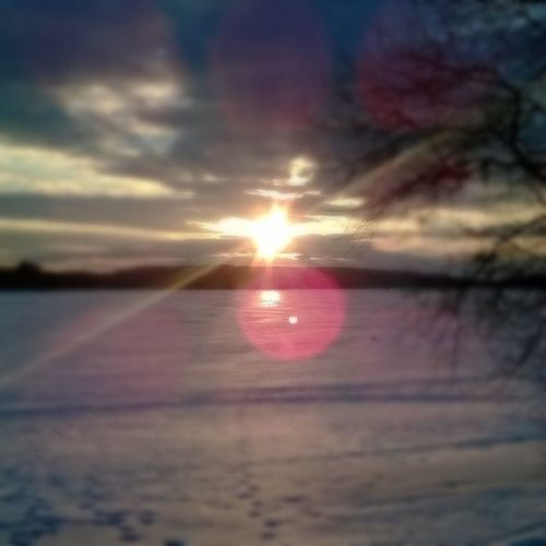 Sunset over a frozen lake. WheninMaine