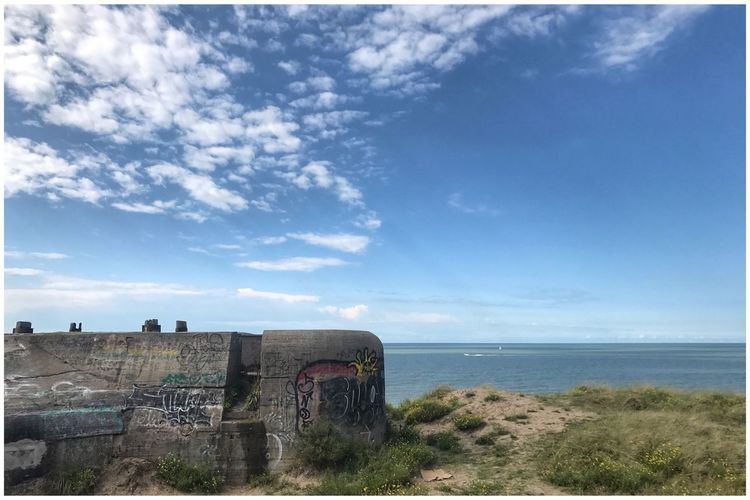 Atlantikwall Horizon Over Water Sea Sky Cloud - Sky Day Water Nature Scenics No People Tranquil Scene Beauty In Nature Outdoors Tranquility Abandoned Blue Built Structure Kris Demey Photography Coastline Bunker Architecture Beach Grass