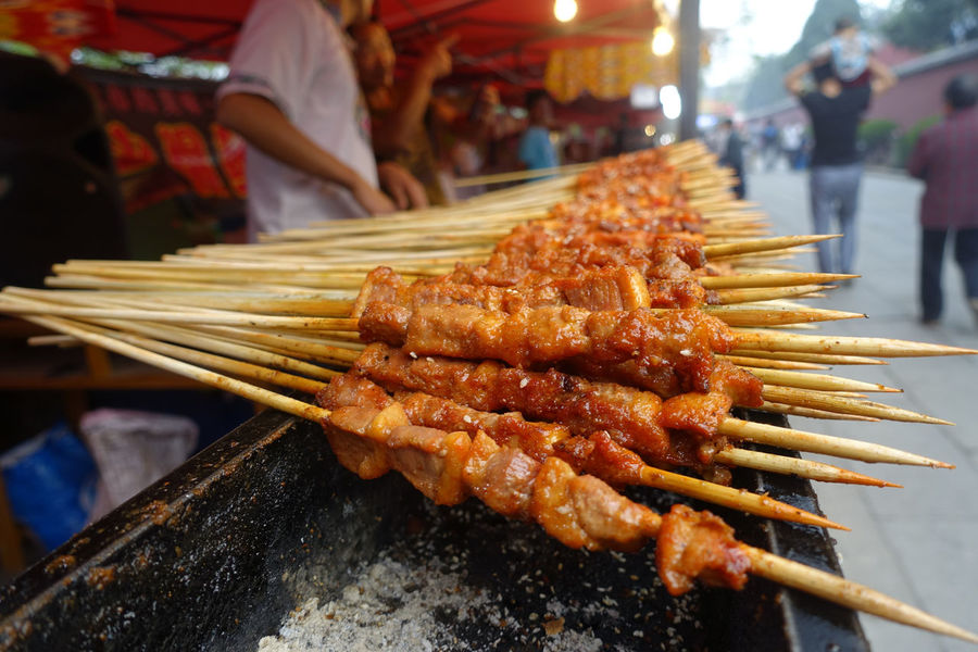Mutton skewers Chinese Street Food Close-up Focus On Foreground Food Food And Drink Freshness Grilled Meat Healthy Eating Human Body Part Human Hand Incidental People Market Market Stall Meat Mutton Night One Person Outdoors People Ready-to-eat Real People Skewer Food Stories