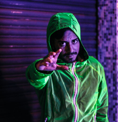 Nightphotography Green Color Hood - Clothing Looking At Camera Men Mid Adult Neon neon life Night One Person Portrait Young Adult Young Men
