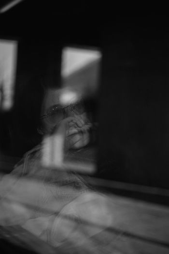 Window Reflection Blackandwhite Black And White Woman Of EyeEm Street Portrait Portrait Of A Woman Indoors  Real People One Person Headshot Lifestyles Women Portrait Young Women Glasses Human Body Part