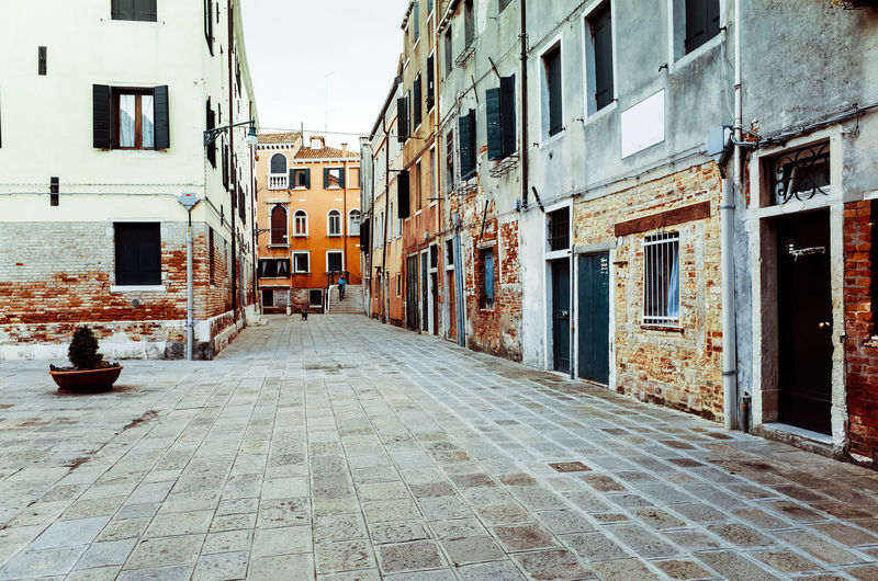 Alley Architecture Building Building Exterior Built Structure City City Life Cobblestone Day Diminishing Perspective Empty Narrow No People Outdoors Residential Building Residential District Residential Structure Sky The Way Forward Town Vanishing Point Walkway