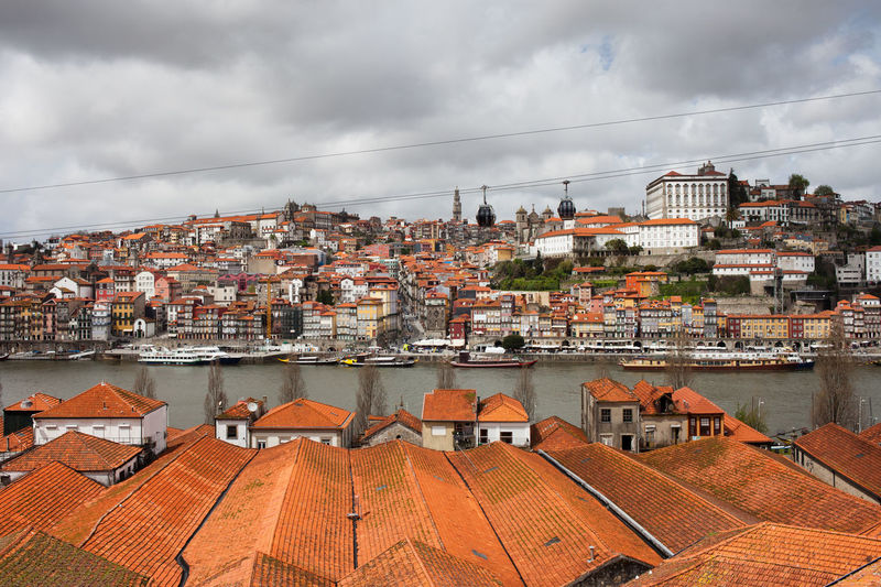 City skyline of Porto in Portugal, view from Vila Nova de Gaia Douro  Houses Old Town Oporto Porto Portugal Rooftop Skyline Travel Travel Photography Architecture Building Exterior Buildings Built Structure City Cityscape Europe Red Roofs Red Tiles River Roof Travel Destinations Urban Urban Landscape Urban Skyline