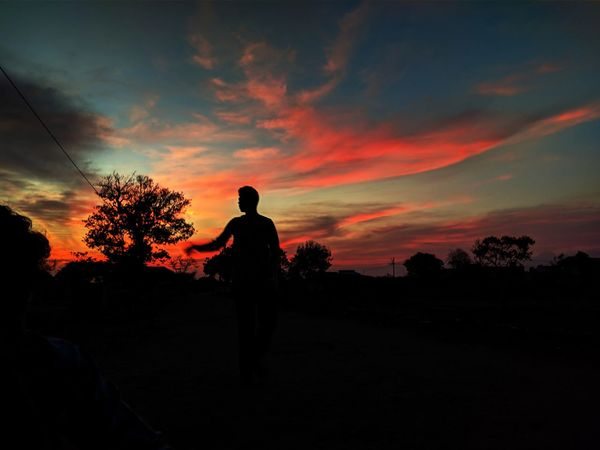 #rural. #redsky #human Tree Politics And Government Tree Area Sunset Silhouette Standing Rural Scene Sky Landscape Cloud - Sky