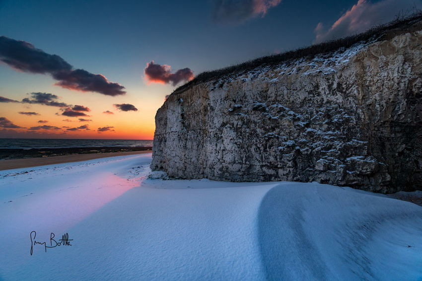 A snow covered Joss Bay beach at sunrise . Sunrise Sky Outdoors Beauty In Nature Landscape Cold Temperature Winter Snow Covered Sunrise_sunsets_aroundworld Landscape_photography Sunrise_Collection Sony A6500 England, UK EyeEm Masterclass Broadstairs Dawn Of A New Day Landscape_Collection Snowscape