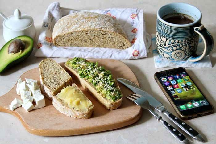 Breakfast, food, bread, toasts, knife and fork, cutting board, wooden, avocado, healthy, still life food, cheese, feta, cup, coffee, salt, mobile phone, top view, lifestyle, nutrition, organic food, honey, whole grains, sesame, seeds, tasty, eating, home, homemade, kitchen ware Bread Food And Drink Food SLICE High Angle View Healthy Eating Breakfast No People Freshness Indoors  Sandwich Toasted Bread Close-up Day Ready-to-eat Abocado Toast Kitchen Utensils Sliced Bread