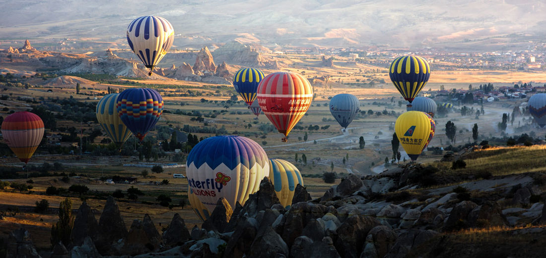 Adventure Air Vehicle Ballooning Festival Day Flying Hot Air Balloon Landscape Mid-air Mountain Nature No People Outdoors Rock - Object Rock Formation Rock Hoodoo Sky Sunrise Traditional Festival Transportation Travel Destinations