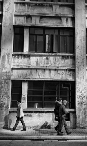 Building Exterior Window Architecture Built Structure Building Outdoors Full Length Men Women Real People City Day Togetherness Adults Only People Adult Architecture IPhone Black And White Photography IPhoneography Blackandwhite Photography Blackandwhite HongKong Black And White Architecture_bw Stories From The City