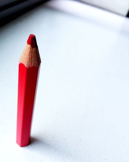 Close-Up Of Red Pencil On Table