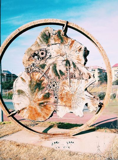 Close-up of bicycle wheel against sky in city