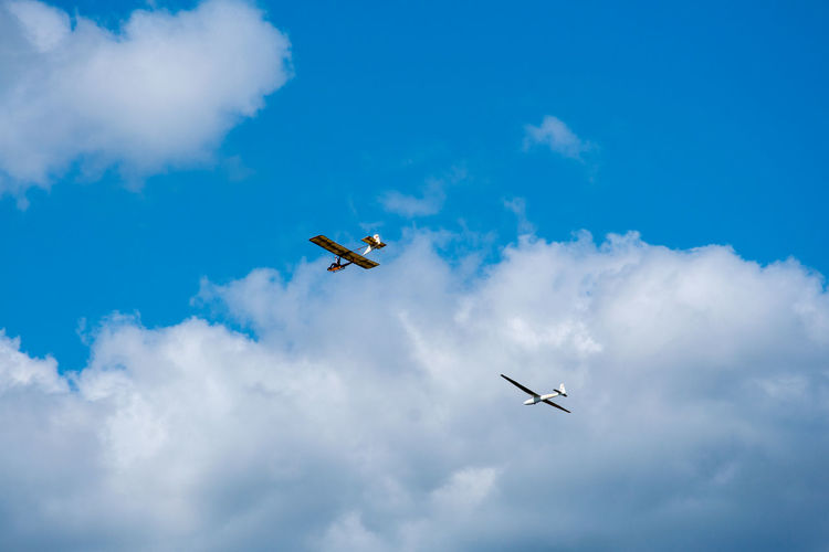 Air Vehicle Airplane Airshow Beauty In Nature Blue Cloud - Sky Day Flying Low Angle View Mid-air Mode Of Transportation Motion Nature No People on the move Outdoors Plane Sky Sky Gliding Transportation Travel