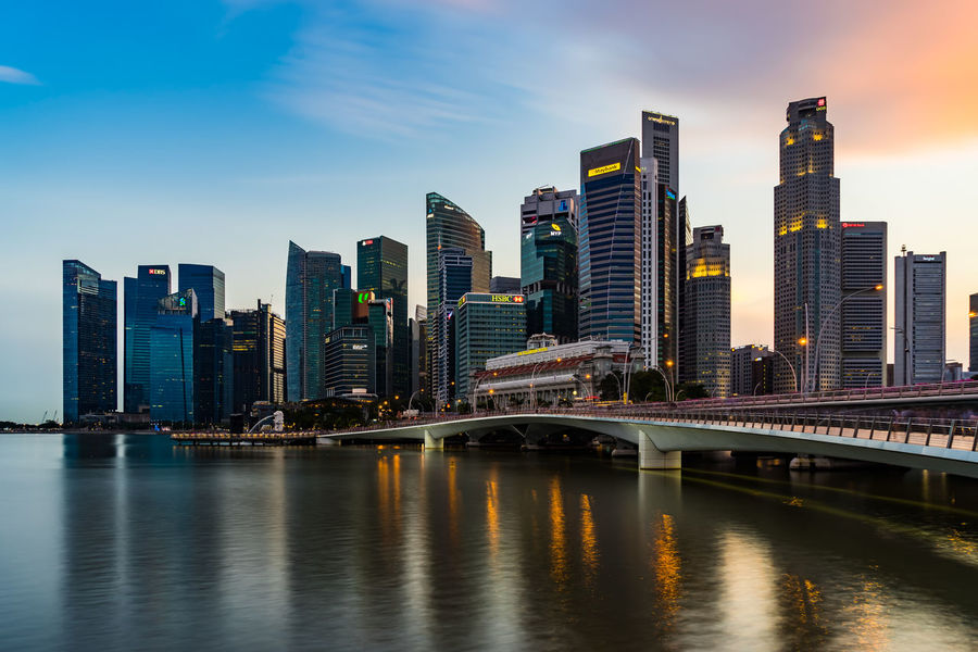 Singapore City Architecture Bridge - Man Made Structure Building Exterior Built Structure City City Life Cityscape Connection Day Downtown District Modern No People Outdoors River Sky Skyscraper Travel Destinations Urban Skyline Water Waterfront