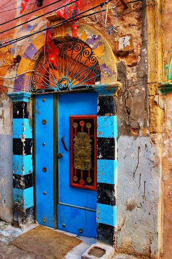 An Old Door with Diffrent Colors at the old city of Tripoli .Libya ©Hiba Shalabi Door Multi Colored Architecture No People Building Exterior Outdoors City هبة_شلابي Detalles Travel Hibashalabi Tripoli Architectural Detail Shadows Cultures Photography Architecture Wwpw2017 WWPW2017MyTLy Libya Lights Art Traditional Culture Blue Old Door