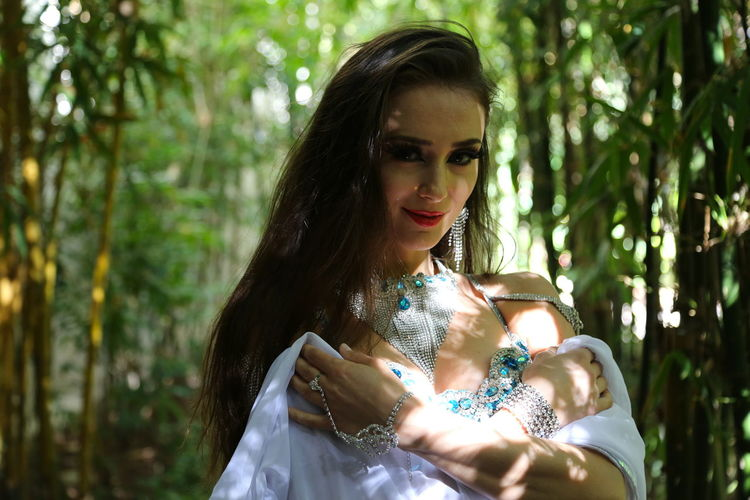 Portrait of beautiful young bellydancer wearing her belly dancing outfit and standing outdoors