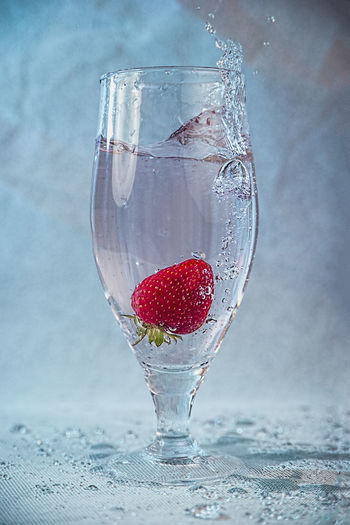 Close-up of red berries on glass