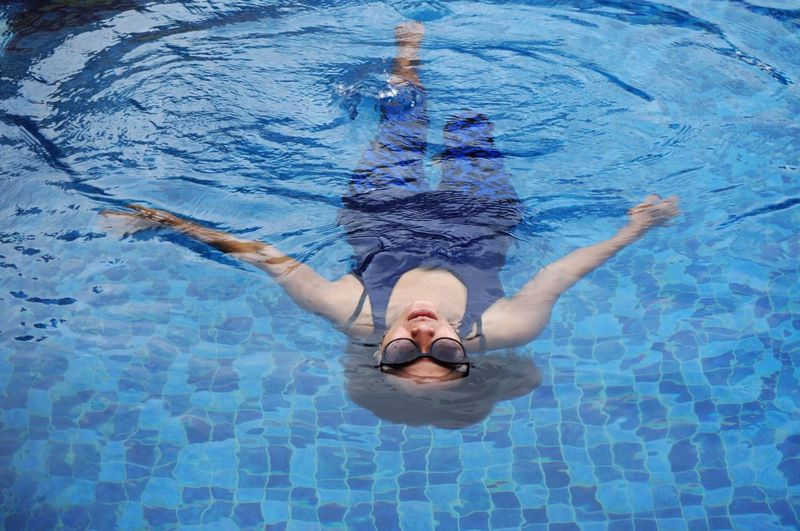 Live For The Story Swimming Pool Water Swimming Underwater Adults Only Only Women High Angle View Lying On Back Leisure Activity Floating On Water Adult Summer Day Healthy Lifestyle People Pool Freshness Lifestyles Blue