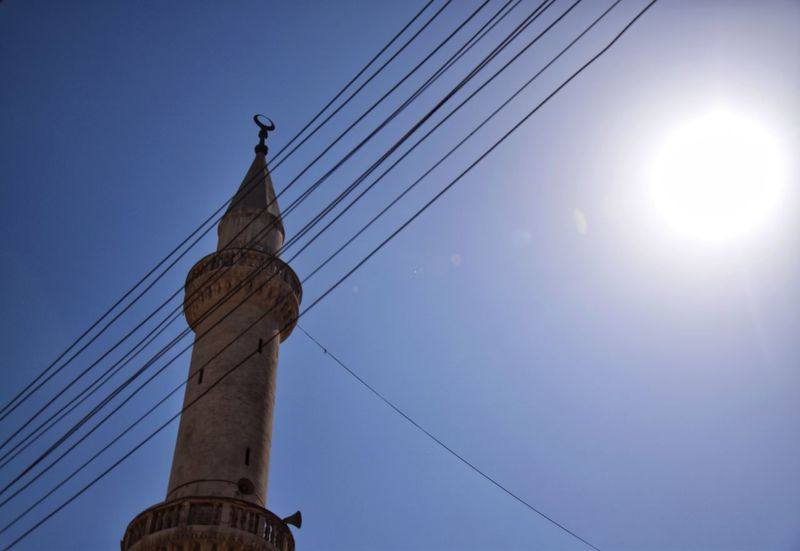 Let the sun shine Outdoors Architecture Day Blue Sky Built Structure Cable Minaretsofworld Minaret EyeEmNewHere The Week On EyeEm Filmphoto EyeEm Gallery Streetphotography Low Angle View Tower Architecture Religion Sun Sunlight Sunshine EyeEm Best Shots Clear Sky EyeEm Best Edits Creativity Photos