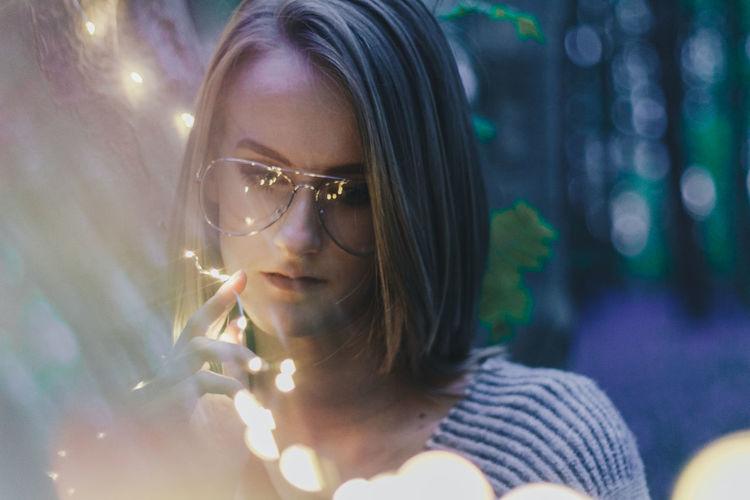 Woman in eyeglasses at night