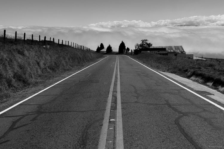 In middle of the street Cloud Cloud - Sky Country Road Day Diminishing Perspective Empty Landscape Road Road Marking Sky The Way Forward Tranquil Scene Tranquility Vanishing Point Walking