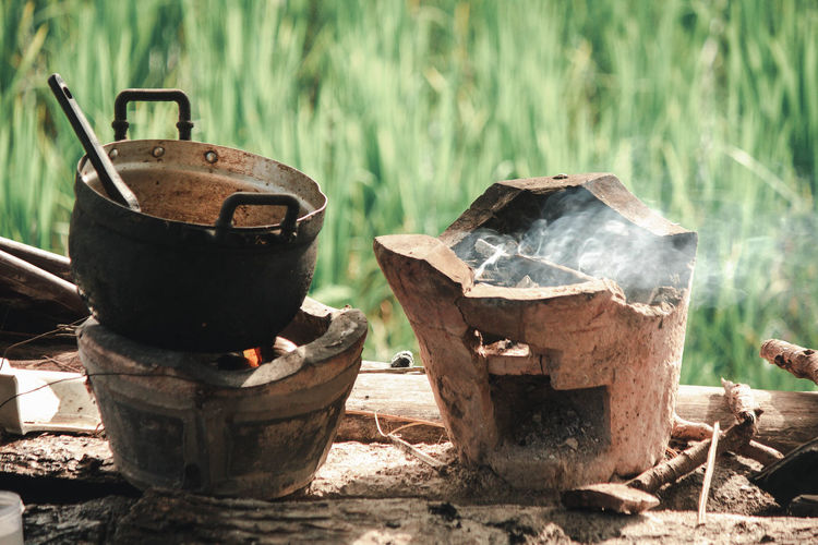 My Farm Bonfire Burning Camping Camping Stove Container Day Fire Firewood Focus On Foreground Forest Grass Heat - Temperature Log Metal Nature No People Outdoors Plant Smoke - Physical Structure Tree Wood Wood - Material