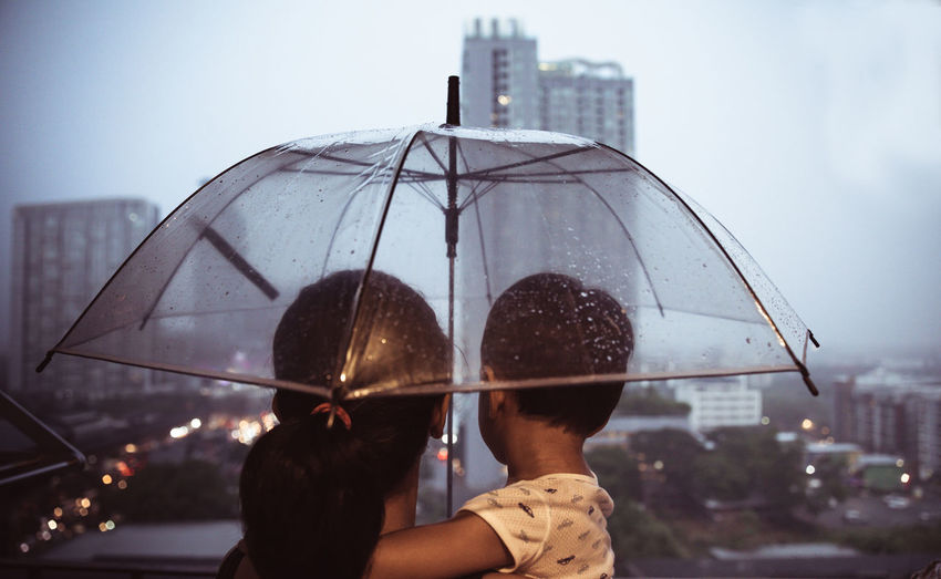 Rear view of man and woman in rain