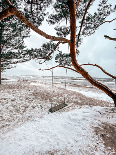 View of swing against sky during winter