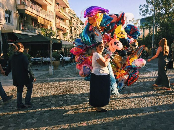 Balloon Balloons Disney Street Photography Streetphotography Golden Hour Street Vendor Windy Storytelling Retold Up Close Street Photography