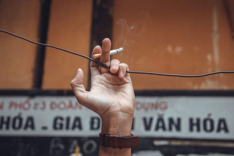 Smoke EyeEm Selects Human Hand Holding Communication Hand Focus On Foreground Human Body Part