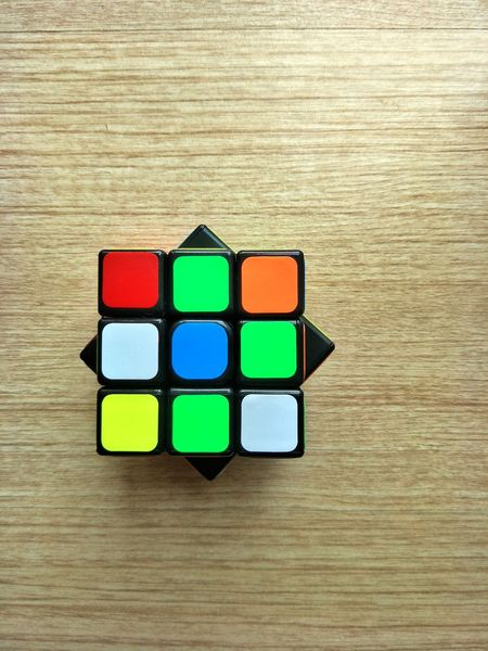 The rubik cube on the floor Rubik Cube Cube Color Cube Colors Veneer Flooring Natural Light Square Meru Directly Above Indoors  Toy Block Text High Angle View Multi Colored Green Color Leisure Games