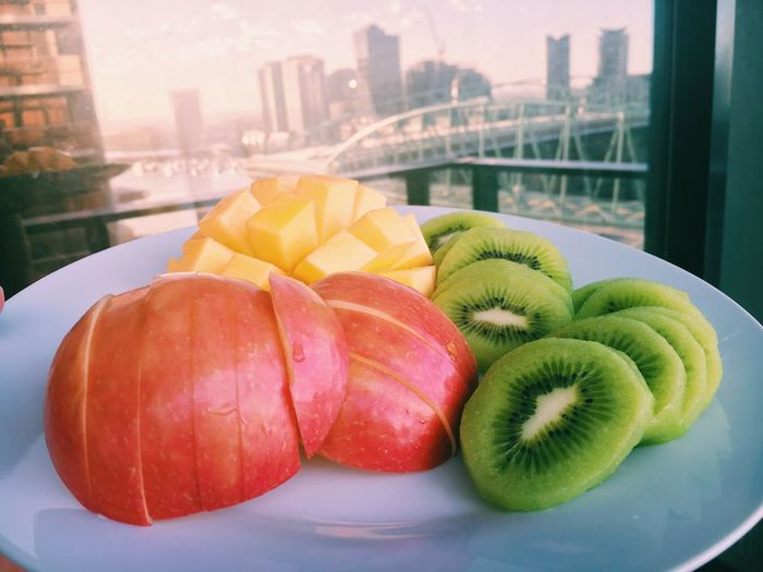 Close-Up Of Fruits In Plate By Window