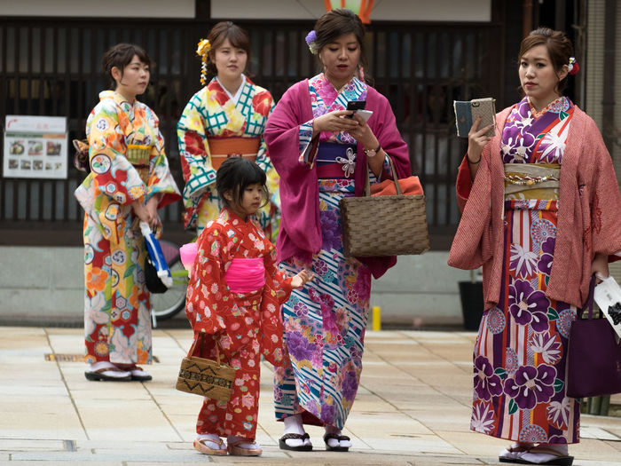 Full length of children in traditional clothing