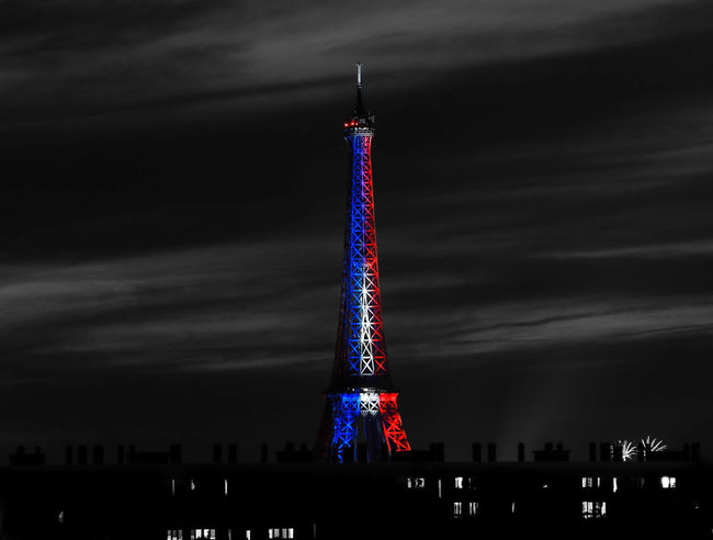 Eiffel Tower lit with the colors of the French flag. Eiffel Tower France Paris Bastilleday Blackandwhite Bluewhitered Eiffel_tower  Eiffeltower Firework Display Frenchphotographer Illuminated Landscape Love_paris Loves_france Loves_paris Mybeautifulparis Night No People OnlyinParis Parisjetaime Photographer Photography Roofofparis Rooftops Toureiffel