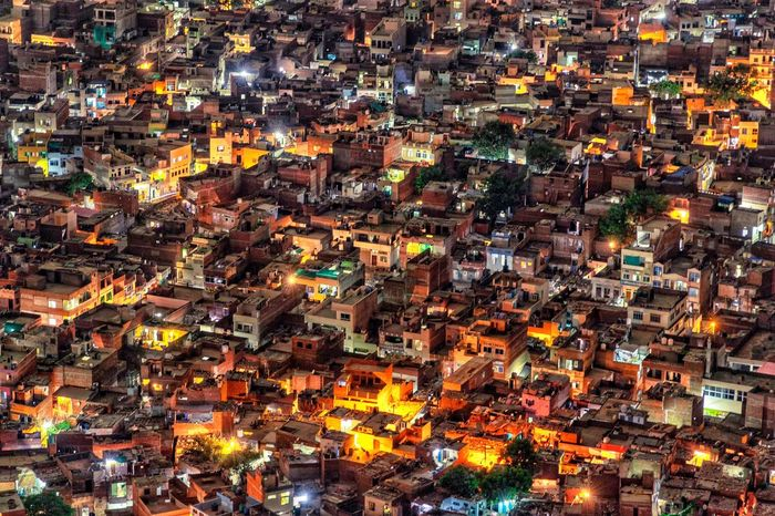 The lit city Backgrounds Full Frame Illuminated Architecture City Building Exterior Cityscape High Angle View Crowd Built Structure Night Aerial View Nature Crowded Building Outdoors City Life Residential District Glowing Capture Tomorrow